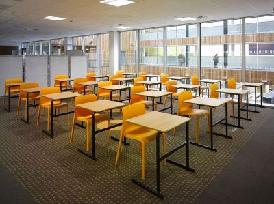 College Lecture Hall Using POP Orange Stackable Furniture