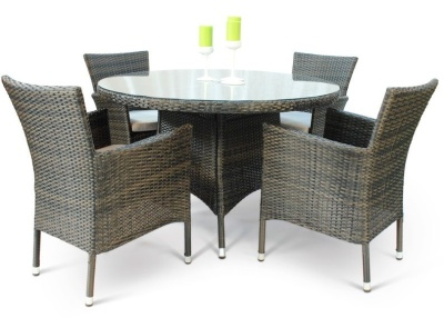 Cuba Four Person Dining Set With A Round Glass Table Side View