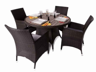 Cubna Four Person Dining Set With A Round Teak Effect Top Side View