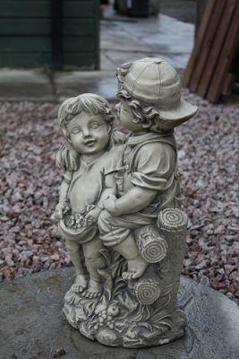 Boy & Girl Sat on Fence