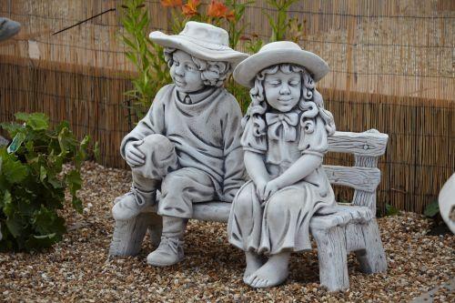 Boy & Girl on Garden Bench