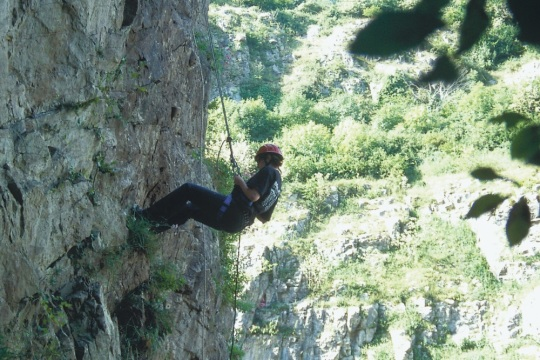 Climber ascending up Cheddar Gorge, part of an X-treme Adventure Group